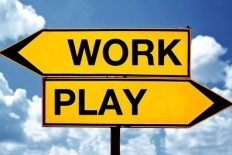 Work or play, opposite signs. Two opposite signs against blue sky background.