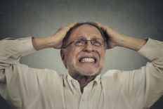Closeup portrait headshot furious frustrated elderly man having bad hard day screaming looking up isolated on gray wall background. Negative face expression emotion